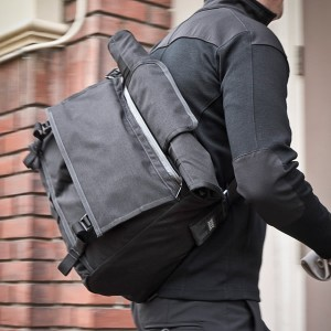 The Rummy messenger bag showing roll top compartment